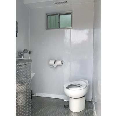 Climate controlled portable toilet for rent